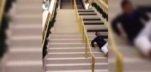 man falls down piano stairs