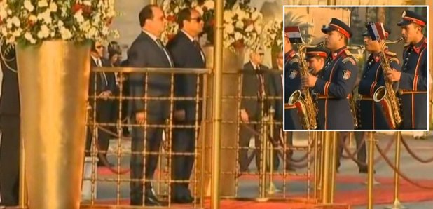 Francois Hollande listens to massacre of French na